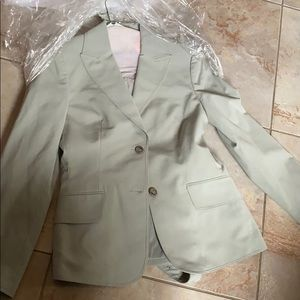 The limited light grey suit size 6